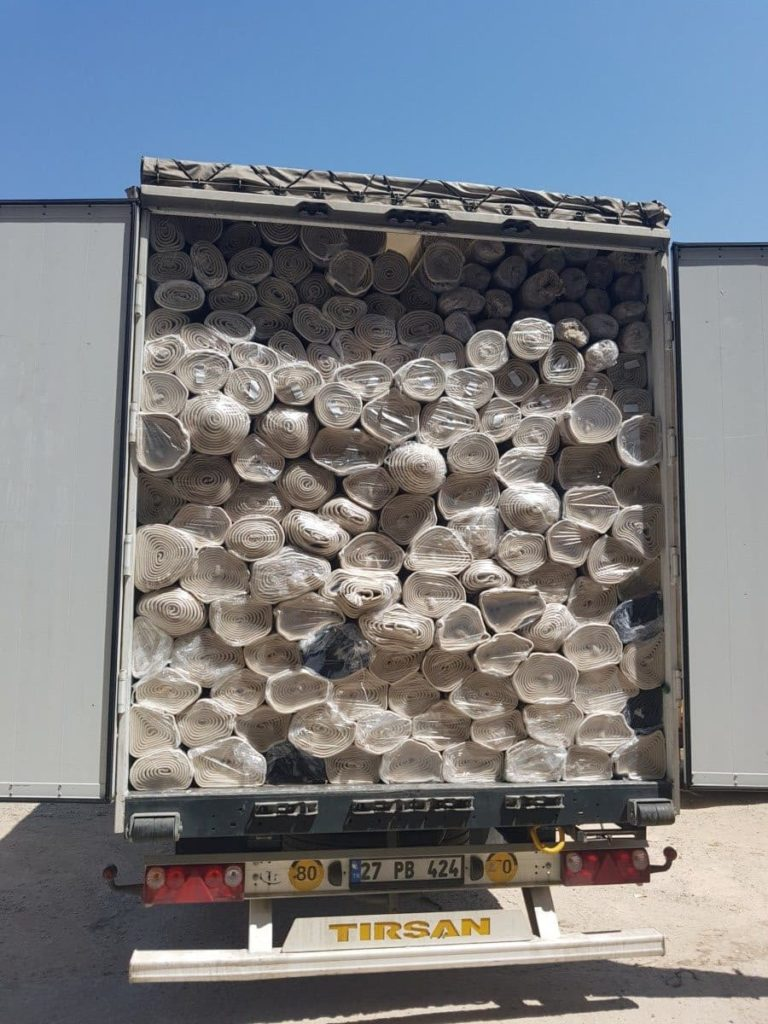 Rugs and Carpets Truck Loading image